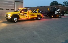 Bock's Service yellow light-duty tow truck