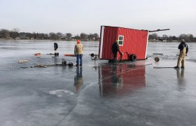 Bock's Service called to a lake to recover a fish house that is falling through the ice